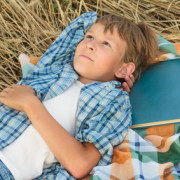Teenage boy lying and thinking inspired by book